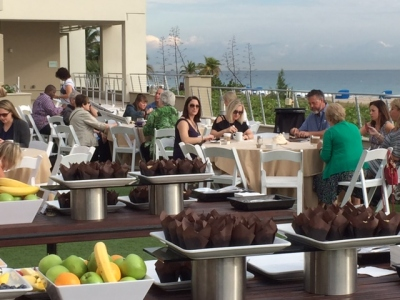 Attendees enjoy an ocean side breakfast